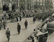 Photograph of soldiers marching past the Town  Hall in Monmouth, watched by civic dignitaries and a crowd of onlookers